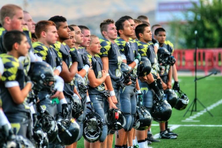 football team during national anthem